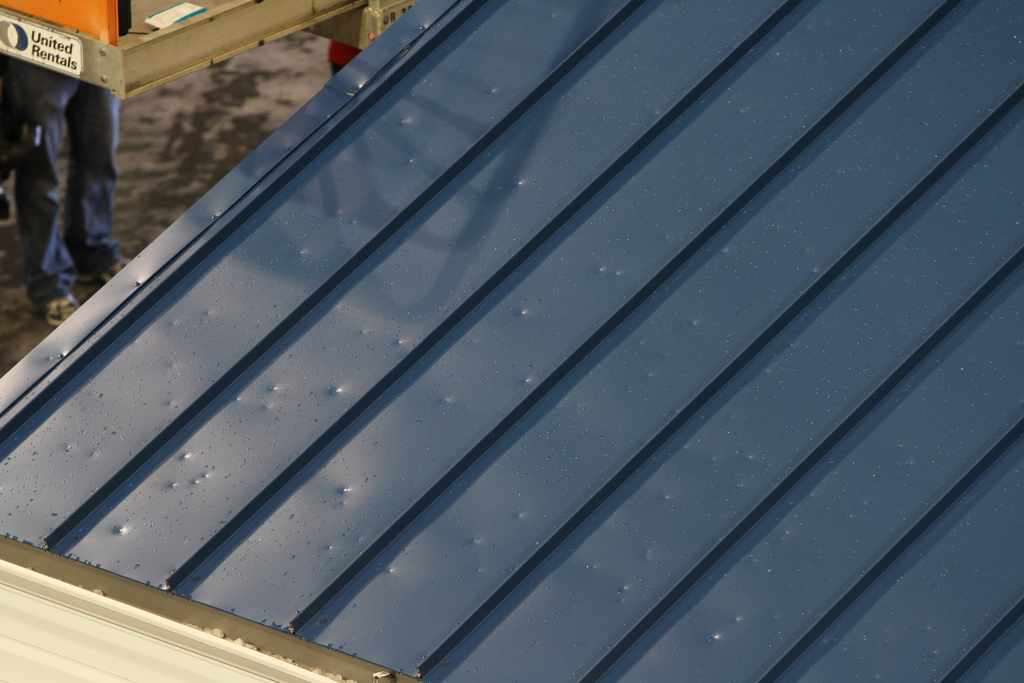 College Station roofer inspects hail damage on roofs in College Station, TX