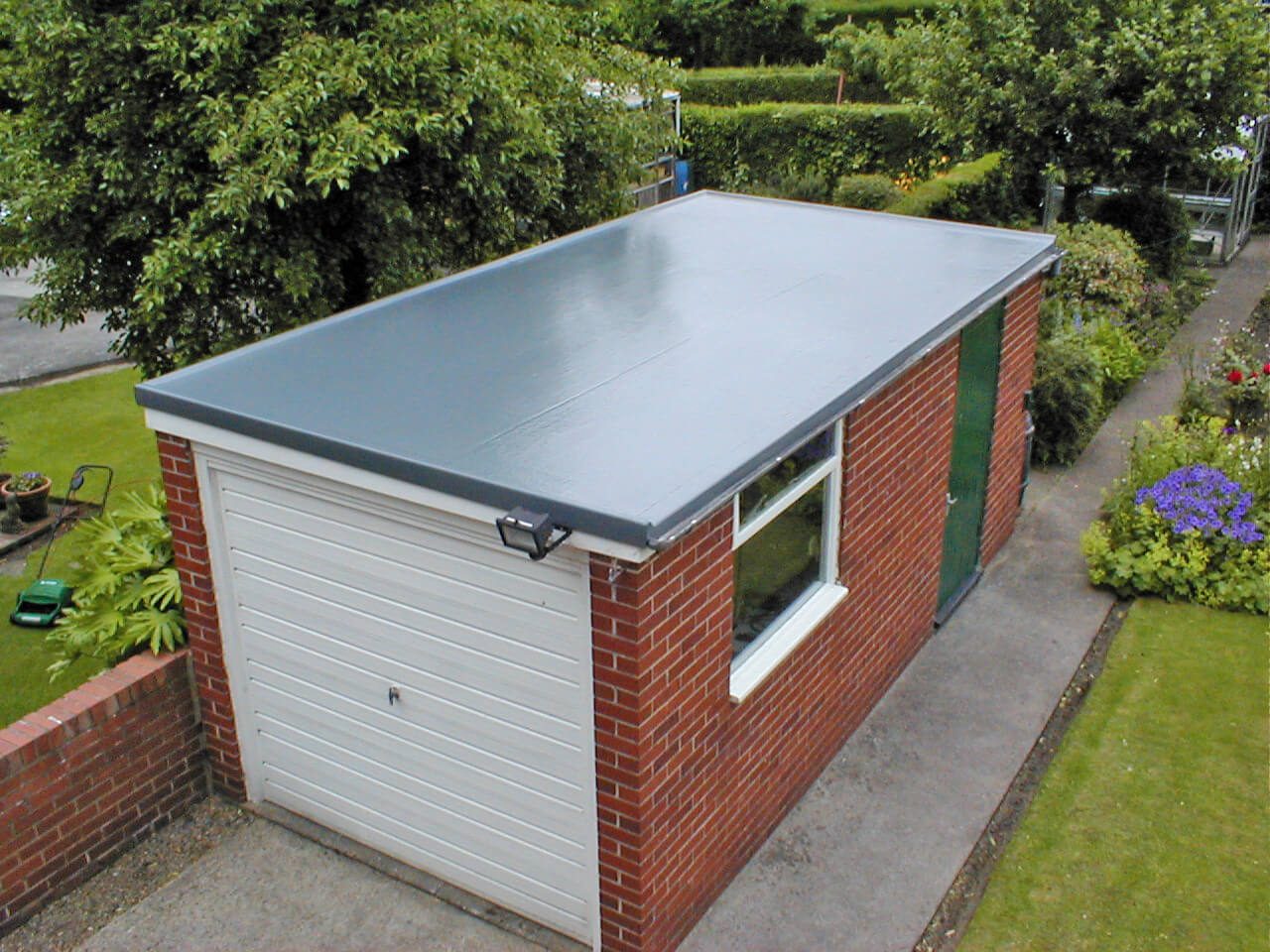 Schulte Roofing Garage with a Flat Roof